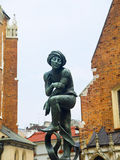 Statue by Church of Mariacki or St Marys Church in Krakow Poland Stock Images