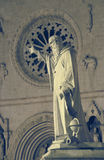 The statue and the church of St. Benedict in Norcia, Umbria, Ita Stock Photos