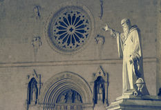 The statue and the church of St. Benedict in Norcia, Umbria, Ita. The statue of St. Benedict, erected in 1880 on the 1400th anniversary of his birth. Norcia Stock Photography
