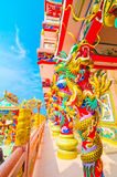 Statue cinesi del drago intorno al palo Immagine Stock Libera da Diritti