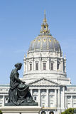 Statue with City Hall dome Stock Image