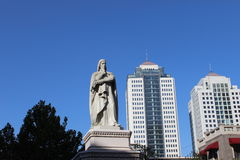 A statue in city tianjin China. Among the modern buildings Stock Photography