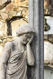Statue of a classical woman regretting the loss of a beloved one Stock Photos