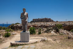 Statue of Cleobulus of Lindos. Poet of ancient Greece. In the background ancient acropolis and city Stock Image