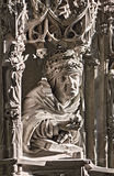 Statue of cleric. In the lighting through the gothic window, Stephansdom Vienna stock image