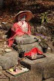 Statue with clothes in Nikko Japan temple stock image