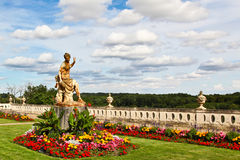 Statue and clouds. A statue at he Chateau de Valencay, Loire Valley, France Royalty Free Stock Photos