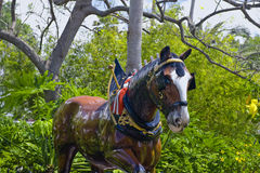 Statue of Clydesdale horse. A view of the statue of a Clydesdale horse in a wooded setting royalty free stock images