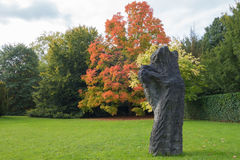 Statue in colourful autumn landscape Royalty Free Stock Photos