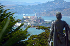 Statue of Columbus looks at Alcatraz Island San Francisco bay Royalty Free Stock Photo
