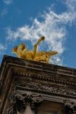 Statue on column at Alexander III bridge in Paris Stock Image