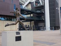 A statue commemorates AFL footballer Malcolm Blight. The statue shows Blight launching a long kick at in front of Adelaide Oval. ADELAIDE, SOUTH AUSTRALIA. - On stock photos