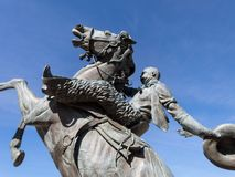 Statue commemorates rodeo in Prescott, Arizona. Rodeo in Prescott, Arizona is celebrated with a statue at city hall royalty free stock images