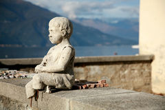 Statue on Como Lake, Italy. Statue of boy on Como Lake, Italy stock images