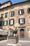 Statue and birth house of composer Giuseppe Rossini, Lucca, Italy. Statue of composer Giuseppe Rossini, his birth house arranged as a Rossini`s museum, Lucca royalty free stock photo
