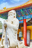 Statue of Confucius, the great Chinese philosopher in Temple of Stock Photos