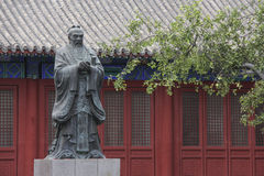 Statue of Confucius in the Temple of Confucius in Beijing. China. The temple is to commemorate ancient Chinese educator Confucius, the founder of Confucianism Royalty Free Stock Photo