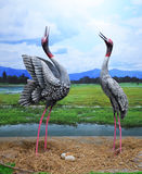 Statue cranes birds Stock Photo