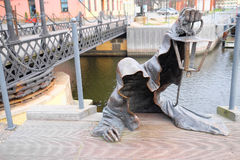 Statue of the creeping ghost on the embankment of Klaipeda, Lith Royalty Free Stock Image