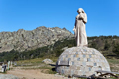 Statue of Crist Roi in Vergio Mountain pass in Corsica. Statue of Crist Roi made with monolith of rose granite in Col de Vergio, separating Porto and Golo Valley Stock Images