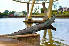 Statue Of Bronze Crocodile At The Riverbank Of Sarawak`s River In Kuching, Sarawak stock photos