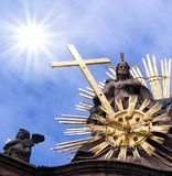 Statue with cross. A statue with cross against the blue sky royalty free stock image
