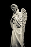 Statue of crying angel, isolated on black Stock Images
