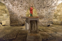 Statue in the Crypt, Split, Croatia. A statue and altar in St Lucy`s crypt, which lies under the Cathedral of Saint Domnius in the Diocletian`s Palace in the royalty free stock photo