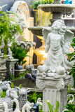 Statue of Cupid in cozy garden. Royalty Free Stock Images