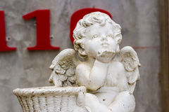 Statue of cupid in garden Stock Photography
