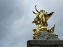 Statue d'or Photographie stock libre de droits