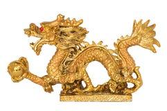 Statue d'or de dragon sur le fond blanc Image libre de droits