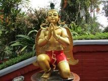 Statue d'or de Namaste Images libres de droits
