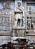 An ancient architectonic detail. Statue of Dacian from Arch of Constantine in Rome Stock Photos