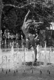 Statue of dancer in a fountain. Black and white image of the statue of a nude woman dancing elegantly in a fountain in front of Ivan Vazov theater in Sofia Royalty Free Stock Image