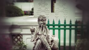 Statue dans le temple d'Arun, Bangkok Photographie stock