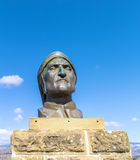 Statue of Dante Alighieri. A statue of the Italian poet Dante Alighieri placed in front of the castle of the Counts Guidi in the town of Poppi, Tuscany, Italy Royalty Free Stock Photography