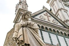 The Statue of Dante Alighieri located in Piazza Santa Croce, next to Basilica of Santa Croce, Florence, Italy. Royalty Free Stock Image