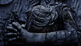 Statue of an Dark Angel Praying Close Up Stock Photo