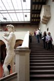 Statue of David on the background of taking photos of tourists. Royalty Free Stock Images