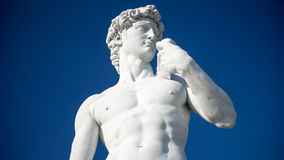 Statue of David,  blue background Stock Photos