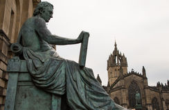 Statue of David Hume with St Gile`s Cathedral in the background, Edinburgh Stock Images