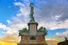 Statue of David at Michelangelo Square on hill in evening during Stock Images