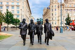 Statue de Beatles au bord de mer de Liverpool photos stock