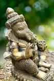 Statue de Ganesha sur le fond vert Images libres de droits