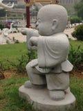Statue de moine bouddhiste Photos stock