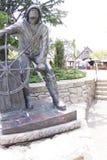Statue de pêcheur dans le port d'amitié Image stock