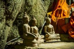 Statue de trois Bouddha dans la caverne Photos libres de droits