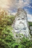 Statue of Decebal's face near Danube river. The statue of Decebal's face, carved in the mountain royalty free stock photography