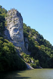 Statue of Decebalus. The Statue of Dacian king Decebalus is a 40-meter high statue that is the tallest rock sculpture in Europe. It is located on the Danube's Stock Images